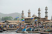 SIERRA LEONE fishing harbour and mosque in Tombo, food security and the livelyhood of small fishermen are affected by international big trawler fleet / SIERRA LEONE Fischerhafen Tombo, die Ernaehrungssicherung der Kuestenbewohner und die Existenz von Kuestenfischern ist durch Ueberfischung grosser Trawler Flotten bedroht
