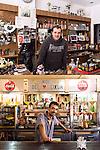 OPERE D'ARTE<br /> Luigi del B.A.R.L.U.I.G.I.<br /> Hocine Belhamri, barista<br /> <br /> Un bar di periferia<br /> con le foto e le coppe,<br /> clienti alla mattina <br /> un manipolo a pranzo<br /> pochi al pomeriggio.<br /> Impiegati, muratori, bottegai <br /> sempre gli stessi. <br /> Un posto qualunque di una città.<br /> Ma questo bar è diventato<br /> un'opera d'arte, <br /> un'opera da prendere,<br /> una storia da raccontare. <br /> Un caffè un euro<br /> e l'arte è gratis<br /> pronta da gustare.<br /> <br /> Il re di cuori sorride<br /> malizioso tra le ossa.<br /> Il braccio, le nocche in primo piano.<br /> Questo bar è un'opera d'arte,<br /> una storia lunga da raccontare.