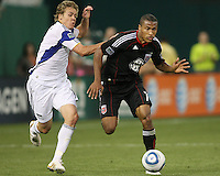 Jordan Graye #16 of D.C.United keeps the ball away from Chance Myers #7 of the Kansas City Wizards during an MLS match at RFK Stadium on May 5 2010, in Washington DC. United won 2-1