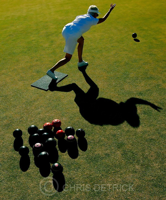 St.George, UT--10/11/06--4:40:39 PM-.Patricia Walker, of Calgary, Alberta, rolls the bowl on the grass, trying to get it as close to the &quot;jack,&quot; another small white ball at the other end of the field, during the under 70's semi-finals game of Lawn Bowling held at the Sunbrook Golf Club. Walkers team of 3 won this game 15-6...*****.//////SUMMARY from http://seniorgames.net/overview.html //////. .The HUNTSMAN WORLD SENIOR GAMES, as it is  known today, began in 1987 as the World Senior Games, an international senior sports competition. n 1989 Jon M. Huntsman, Chairman of the Huntsman Corporation, became the Games' principal sponsor after recognizing that the Games not only fostered lifetime fitness, but also expanded Utah's economic vitality...List of Games played:..Basketball..Bowling..Bridge..Cowboy Shoot..Cycling.Golf..Horseshoes..Lawn Bowls..Mountain Biking..Pickleball.Racewalking..Racquetball..Road Races..Softball..Square Dance.Swimming..Table Tennis..Tennis..Track &amp; Field..Triathlon.Volleyball..Walking Tours..Chris Detrick/Salt Lake Tribune.File #_2CD7181..<br />