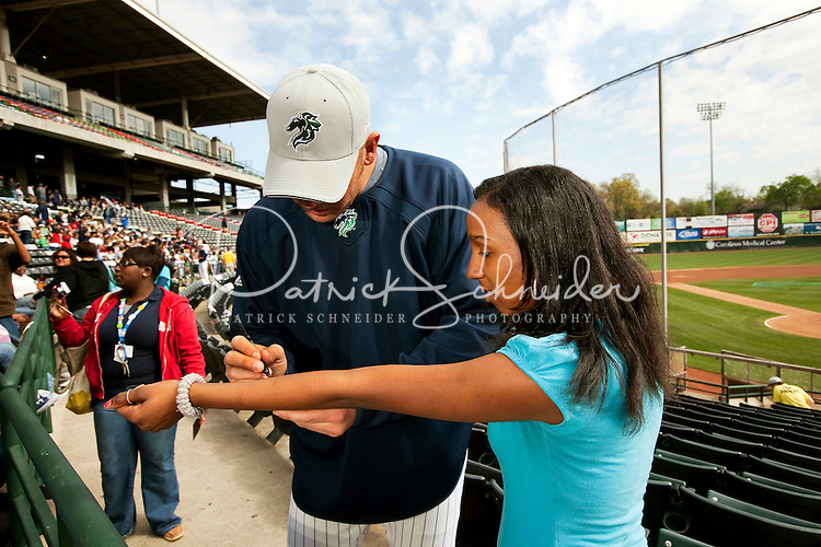 A fan has a player autograph her arm during a game of the Charlotte Knights vs. The Durham Bulls, at Knights Stadium in Forth Mill, South Carolina. The Charlotte Knights are the Triple-A affiliate of the Chicago White Sox.