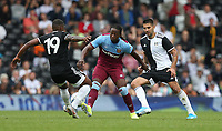 West Ham United's Carlos Sanchez gets in between Fulham's Aleksandar Mitrovic and Ivan Cavaleiro<br /> <br /> Photographer Rob Newell/CameraSport<br /> <br /> Football Pre-Season Friendly - Fulham v West Ham United - Saturday July 27th 2019 - Craven Cottage - London<br /> <br /> World Copyright © 2019 CameraSport. All rights reserved. 43 Linden Ave. Countesthorpe. Leicester. England. LE8 5PG - Tel: +44 (0) 116 277 4147 - admin@camerasport.com - www.camerasport.com