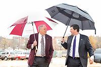 Richard A. Rula, MSU's 2019 National Alumnus of the Year, left, and MSU Vice President for Development and Alumni John Rush make their way through the rain to the groundbreaking ceremony for the Richard A. Rula Engineering and Science Complex. The rain did not slow down the festivities as MSU leaders and supporters broke ground on the $34 million, 74,000-square-foot facility on Friday [Dec. 7]. <br />  (photo by Megan Bean / &copy; Mississippi State University)