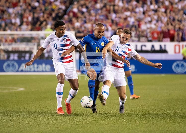 PHILADELPHIA, PA - JUNE 30: Weston Mckennie #8 and Jordan Morris #11 defend against Gino Van Kessel #16 during a game between Curaçao and USMNT at Lincoln Financial Field on June 30, 2019 in Philadelphia, Pennsylvania.