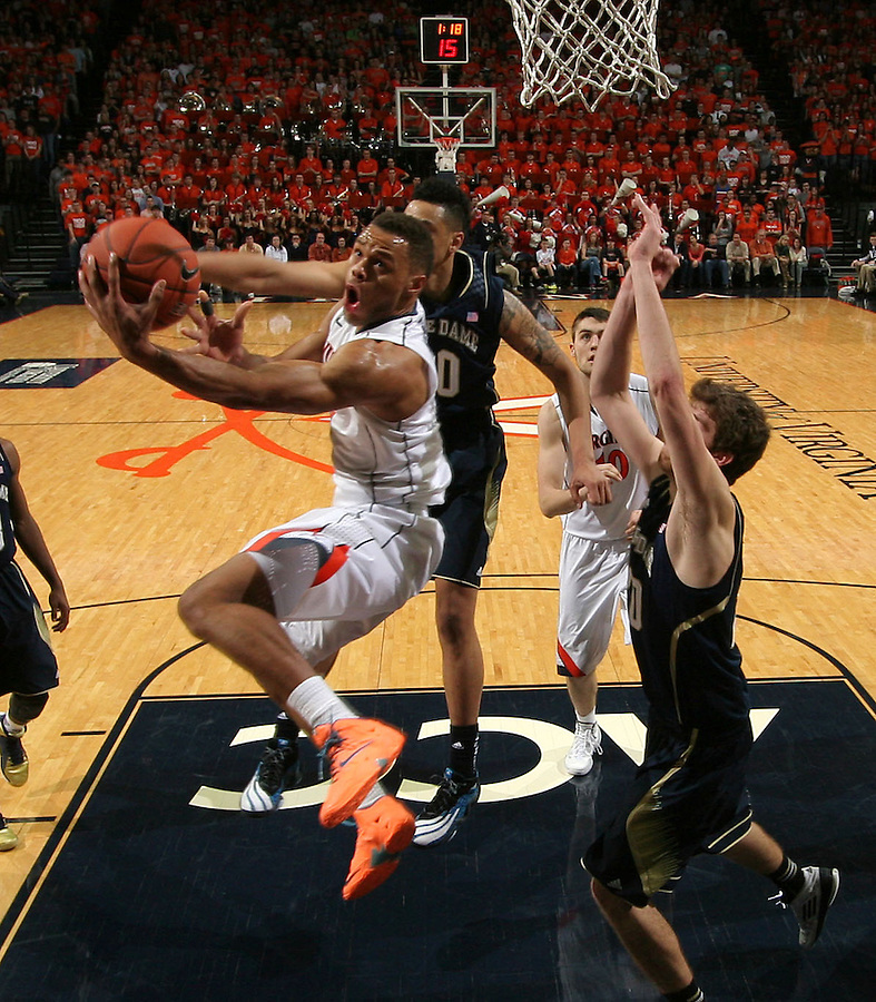 Virginia guard Justin Anderson (1) shoots in front of Notre Dame defenders during the game Saturday, February 22, 2014,  in Charlottesville, VA. Virginia won 70-49.