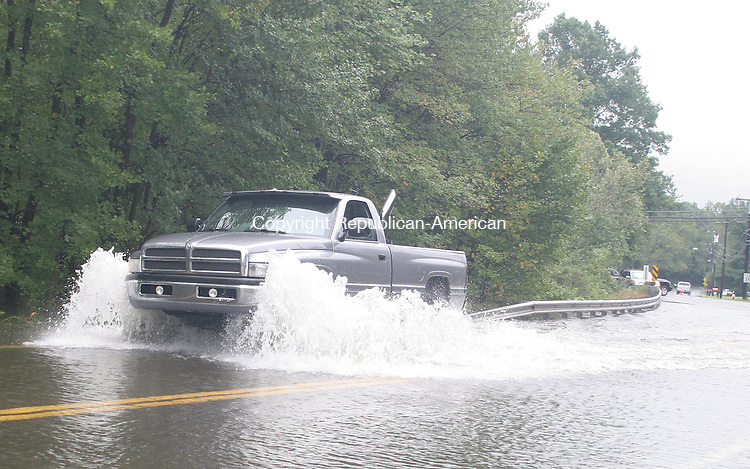 PLYMOUTH, CT.-28 AUGUST 2011-082811JW02-  A pickup truck crosses a flooded setion of Route 72 in Plymouth after the Pequabuck River overflowed its banks due to the rainfall from tropical storm Irene Sunday morning.<br /> Jonathan Wilcox Republican American