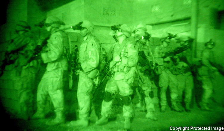 503rd Airborne Infantry Battalion, 173rd Airborne Brigade soldiers prepare to raid a house for suspected arms dealers in the town of Kirkuk, Iraq.  Photo taken early morning Wednesday, May 20, 2003.  Photo by Khampha Bouaphanh
