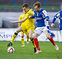 Queen of the South's Paul Burns clears from Cowdenbeath's Kyle Miller.