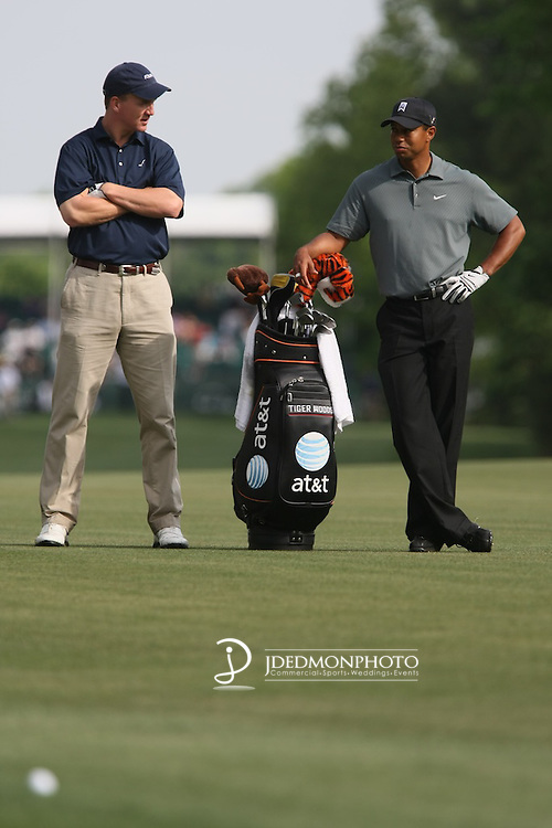 Peyton Manning chats with partner Tiger Woods during the Pro Am of the Quail Hollow Championship in 2009
