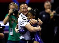 Gabrielle Douglas of Chow's hugs her coach after competing the vault during 2012 US Olympic Trials Gymnastics Finals at HP Pavilion in San Jose, California on July 1st, 2012.