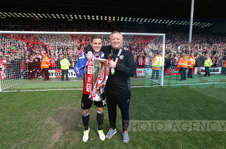 Sheffield United's Billy Sharp and Chris Wilder celebrate with the trophy during the League One match at Bramall Lane, Sheffield. Picture date: April 30th, 2017. Pic David Klein/Sportimage