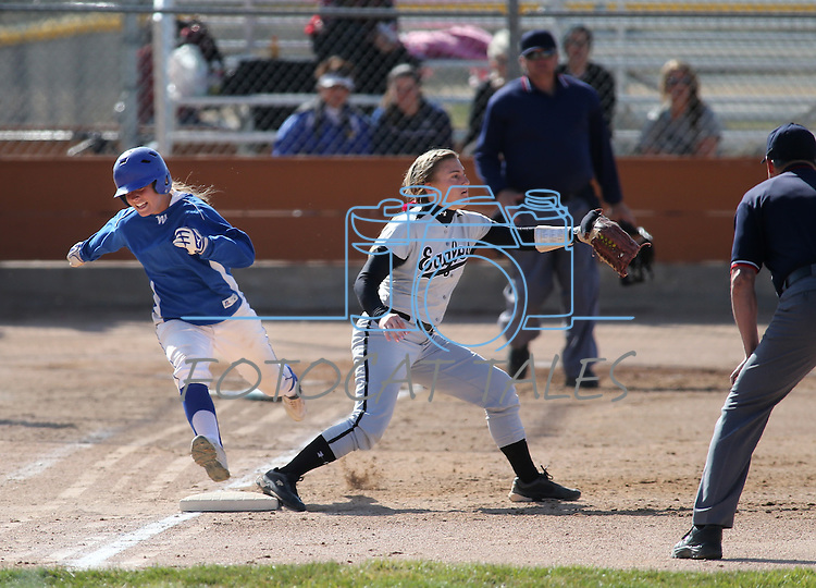 Western Nevada's Jennie Quam runs to first base a college softball game against College of Southern Idaho's Patti Ferguson in Carson City, Nev., on Friday, March 22, 2013..Photo by Cathleen Allison
