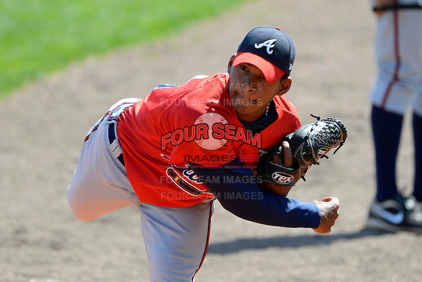 Atlanta Braves pitcher Andry Ubiera #14 throws in the bullpen during a minor league Spring Training game against the Philadelphia Phillies at Al Lang Field on March 14, 2013 in St. Petersburg, Florida.  (Mike Janes/Four Seam Images)