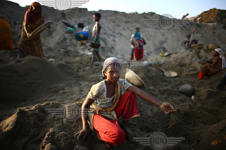 Workers at Bhollar Ghat. At least 10,000 people, including 2,500 women and over 1,000 children, are engaged in stone and sand collection from the Bhollar Ghat on the banks of the Piyain river. Building materials such as stone and sand, and the cement which is made from it, are in short supply in Bangladesh, and commands a high price from building contractors. The average income is around 150 taka (less than 2 USD) a day.