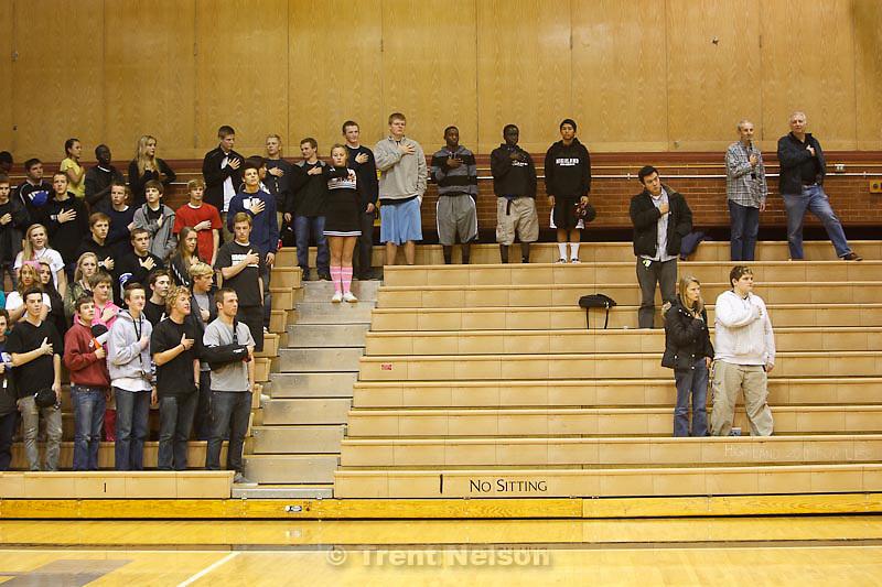 Trent Nelson  |  The Salt Lake Tribune.National anthem, no sitting sign, at Highland vs. Riverton High School basketball in Salt Lake City, Utah, Friday, December 2, 2011. kyle goon