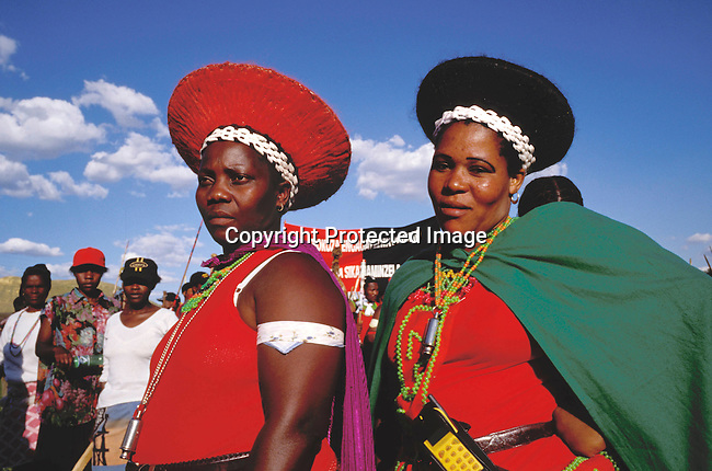 CUZULUS02052.Culture. Zulus. South Africa. Johannesburg. Participants at a Zulu rally. Women wearing colourful clothes and hats, traditional style..©Per-Anders Petterson/iAfrika Photos.