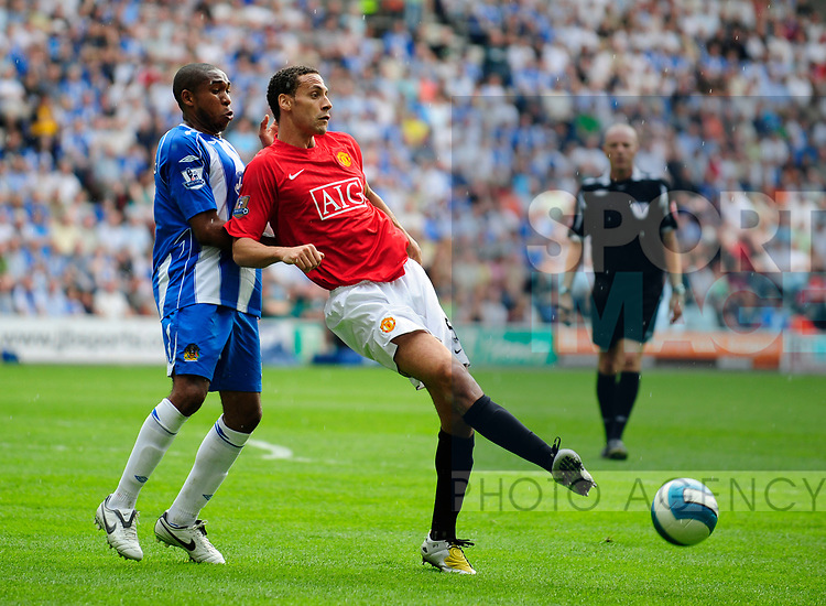 Wilson Palacios of Wigan Athletic and Manchester United's Rio Ferdinand during the Premier League match at The JJB Stadium, Wigan. Picture date 11th May 2008. Picture credit should read: Simon Bellis/Sportimage