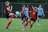 Piscataway, NJ, May 7, 2016.  Taylor Lytle (6) of Sky Blue FC splits Samantha Mewis (5) and Adriana Leon (19) of  the Western New York Flash.  Sky Blue FC took on the Western New York Flash during a National Women's Soccer League (NWSL) match at Yurcak Field.