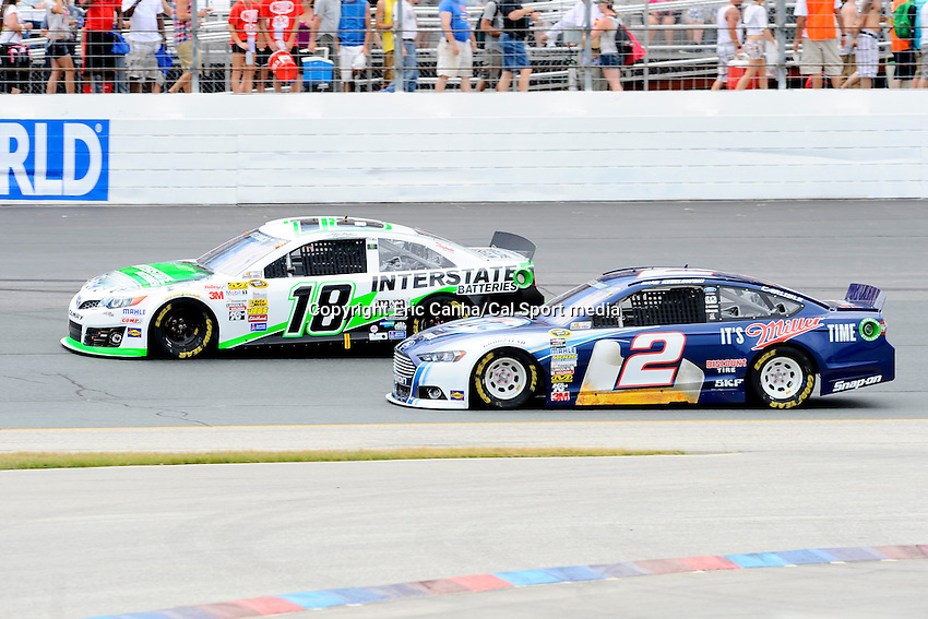 July 14, 2013 - Loudon, New Hampshire U.S. - Sprint Cup Series driver Brad Keselowski (2) takes the inside lane while battling Kyle Busch (18) for position during the NASCAR Sprint Cup Series Camping World RV Sales 301 held at the New Hampshire Motor Speedway in Loudon, New Hampshire.   Eric Canha/CSM