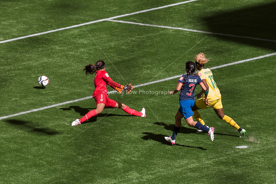June 8, 2015: Gaelle ENGANAMOUIT of Cameroon kicks and scores a goal during a Group C match at the FIFA Women's World Cup Canada 2015 between Cameroon and Ecuador at BC Place Stadium on 8 June 2015 in Vancouver, Canada. Sydney Low/AsteriskImages