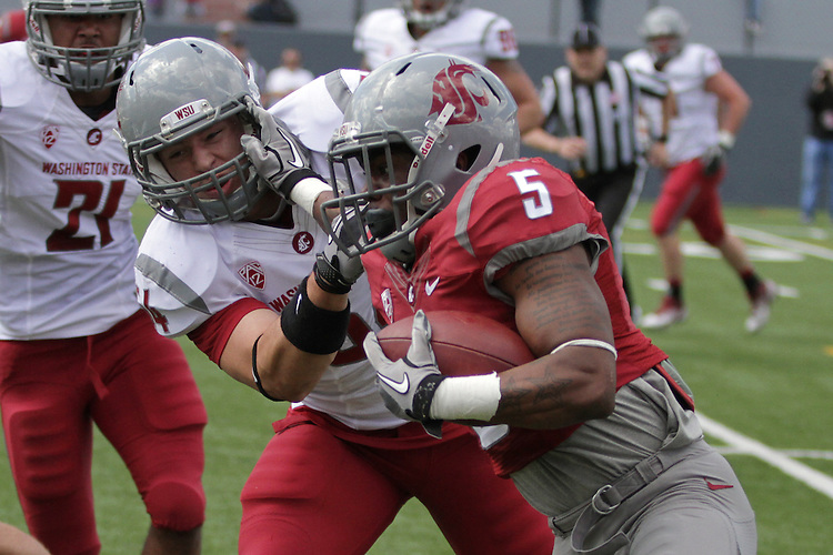 Darren Markle attempts to tackle Rickey Galvin during the Washington State Crimson and Gray game, the culmination of the first spring practice under new head coach Mike Leach, at Joe Albi stadium in Spokane, Washington, on Saturday, April 21, 2012.