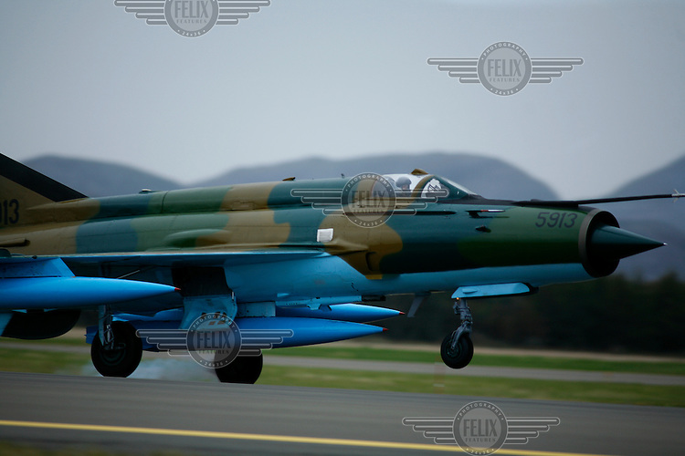 MiG-21 F of the 95th Air Force Base from the Romanian Air Force coming in to land. BOLD AVENGER 2007 (BAR 07), a NATO  air exercise at Ørland Main Air Station, Norway. BAR 07 involved air forces from 13 NATO member nations: Belgium, Canada, the Czech Republic, France, Germany, Greece, Norway, Poland, Romania, Spain, Turkey, the United Kingdom and the United States of America..The exercise was designed to provide training for units in tactical air operations, involving over 100 aircraft, including combat, tanker and airborne early warning aircraft and about 1,450 personnel.