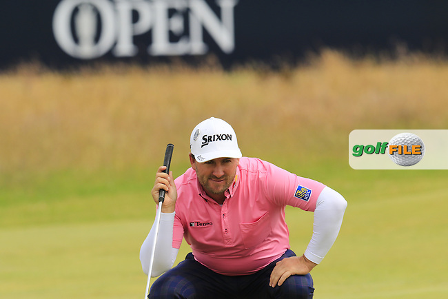 Graeme McDOWELL (NIR) lines up his putt on the 16th green during Monday's Final Round of the 144th Open Championship, St Andrews Old Course, St Andrews, Fife, Scotland. 20/07/2015.<br /> Picture Eoin Clarke, www.golffile.ie