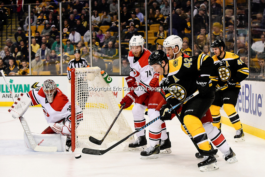 Thursday, December 1, 2016: Boston Bruins right wing David Backes (42) works for the puck in front of Carolina Hurricanes goalie Cam Ward (30) during the National Hockey League game between the Carolina Hurricanes and the Boston Bruins held at TD Garden, in Boston, Mass. Eric Canha/CSM