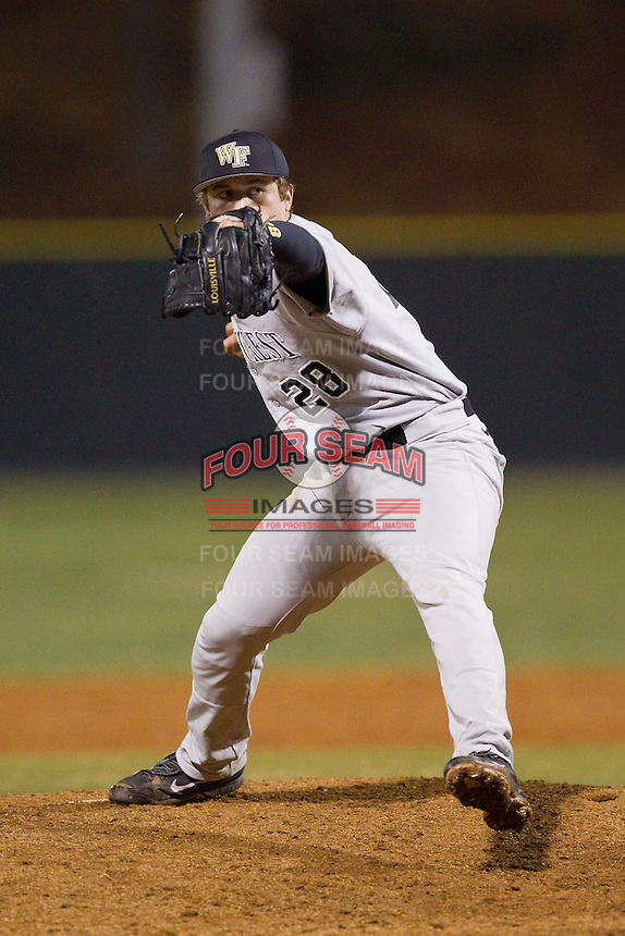 Wake Forest Demon Deacons relief pitcher Garrett Kelly (28) in action against the Davidson Wildcats at Wilson Field on March 19, 2014 in Davidson, North Carolina.  The Wildcats defeated the Demon Deacons 7-6.  (Brian Westerholt/Four Seam Images)
