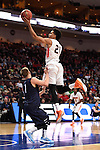 March 7, 2015; Las Vegas, NV, USA; Pepperdine Waves guard Shawn Olden (21) shoots a layup against San Diego Toreros guard Johnny Dee (1) during the first half of the WCC Basketball Championships at Orleans Arena.