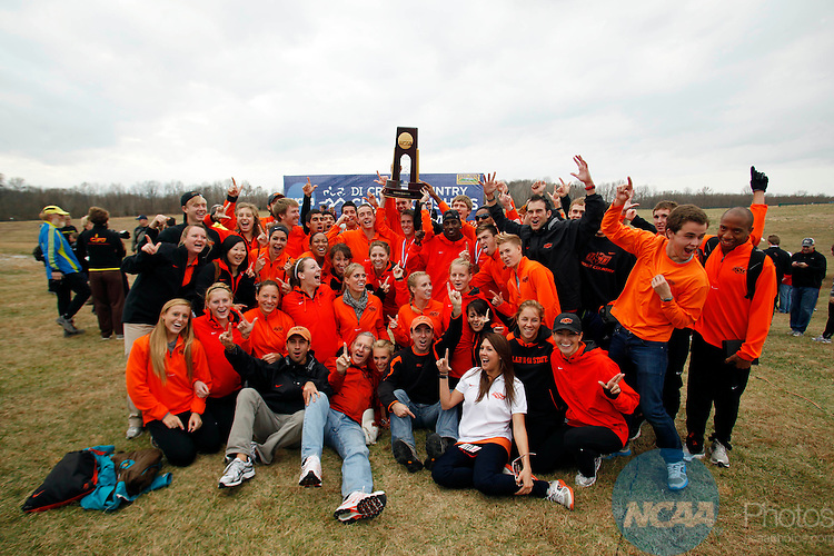 22 NOV 2010:  Oklahoma State University celebrates their team national title during the Division I Men's Cross Country Championship held at the Wabash Valley Family Sports Center in Terre Haute, IN.  Jamie Schwaberow/NCAA Photos