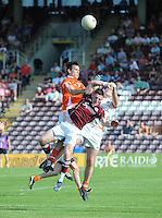 20th July 2013; Danny Cummins, Galway, in action against Mark Sheilds (left) and Philip McEvoy, Armagh. All Ireland Football Senior Championship Round 3, Galway v Armagh, Pearse Stadium, Galway