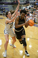 Bentonville's Maryam Dauda (right) drives to the lane Friday, Jan. 17, 2020, as Fayetteville's Sasha Goforth defends during the second half of play in Bulldog Arena in Fayetteville. Visit nwaonline.com/prepbball/ for a gallery from the games.<br /> (NWA Democrat-Gazette/Andy Shupe)