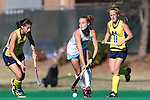 15 November 2015: North Carolina's Eva van't Hoog (NED) (22) is defended by Michigan's Shannon Scavelli (3) and Veerle Lubbers (NED) (11). The University of North Carolina Tar Heels played the University of Michigan Wolverines at Francis E. Henry Stadium in Chapel Hill, North Carolina in a 2015 NCAA Division I Field Hockey Tournament Quarterfinal match. UNC won the game 1-0.