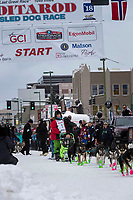 Ryan Redington and team leave the ceremonial start line with an Iditarider and handler at 4th Avenue and D street in downtown Anchorage, Alaska on Saturday March 3rd during the 2018 Iditarod race. Photo ©2018 by Brendan Smith/SchultzPhoto.com
