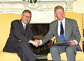 United States President Bill Clinton shakes hands with President Emil Constantinescu of Romania during a working visit in the Oval Office of the White House in Washington, DC on Thursday, July 16, 1998.<br /> Credit: Ron Sachs / CNP