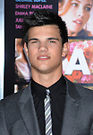 """HOLLYWOOD, CA. - February 08: Taylor Lautner arrives at the """"Valentine's Day"""" Los Angeles Premiere at Grauman's Chinese Theatre on February 8, 2010 in Hollywood, California."""