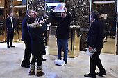 "An unidentified man speaks in Spanish as he holds up a map of the United States with a section labeled ""Mexico in 1830"" as an apparent protest in the lobby of the Trump Tower in New York, NY, on January 4, 2017.<br /> Credit: Anthony Behar / Pool via CNP"