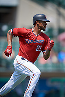 Rochester Red Wings center fielder Byron Buxton (25) runs to first base during a game against the Lehigh Valley IronPigs on July 1, 2018 at Frontier Field in Rochester, New York.  Rochester defeated Lehigh Valley 7-6.  (Mike Janes/Four Seam Images)