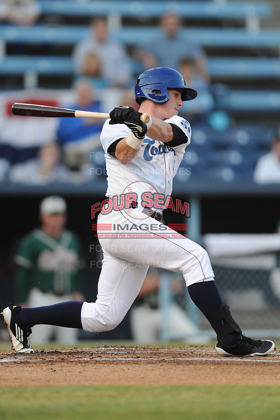 Asheville Tourists center fielder Tyler Massey #5 swings at a pitch during game one of the South Atlantic League, Southern Division playoffs between the Greensboro Grasshoppers and the Asheville Tourists at McCormick Field on September 10, 2012 in Asheville, North Carolina . The Grasshoppers defeated the Tourists 6-3. (Tony Farlow/Four Seam Images).