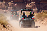 Group on tour of the Moab desert in Polaris RZR side-by-sides