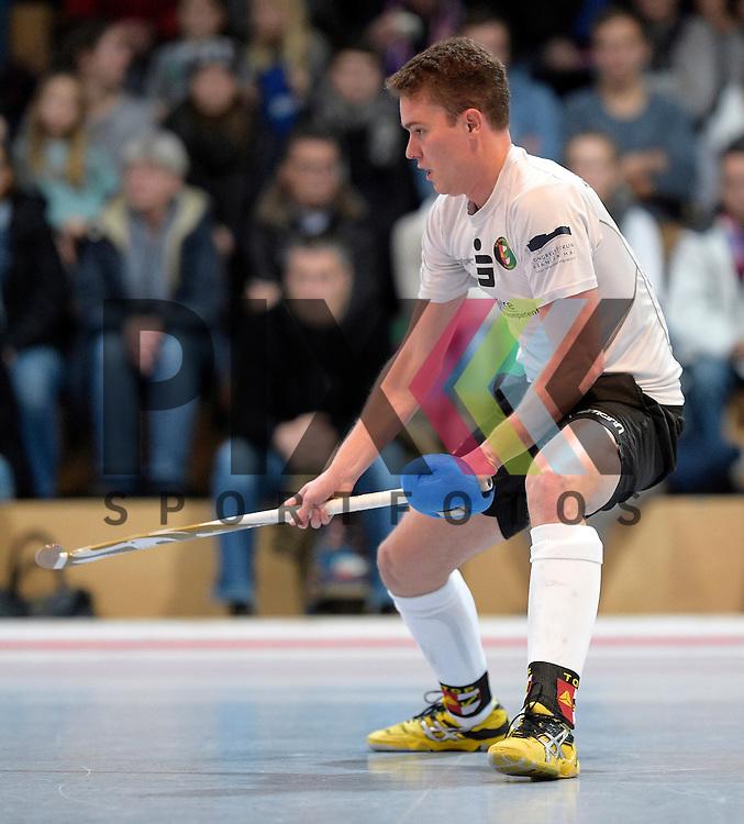 GER - Mannheim, Germany, November 28: During the 1. Bundesliga Sued Herren indoor hockey match between Mannheimer HC (red) and TG Frankenthal (white) on November 28, 2015 at Irma-Roechling-Halle in Mannheim, Germany. Final score 7-7 (HT 3-3).  Hans-Christian Damm #10 of TG Frankenthal<br /> <br /> Foto &copy; PIX-Sportfotos *** Foto ist honorarpflichtig! *** Auf Anfrage in hoeherer Qualitaet/Aufloesung. Belegexemplar erbeten. Veroeffentlichung ausschliesslich fuer journalistisch-publizistische Zwecke. For editorial use only.