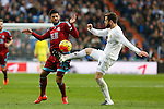 Real Madrid´s Nacho (R) and Real Sociedad´s Carlos Vela during La Liga match between Real Madrid and Real Sociedad at Santiago Bernabeu stadium in Madrid, Spain. December 30, 2015. (ALTERPHOTOS/Victor Blanco)