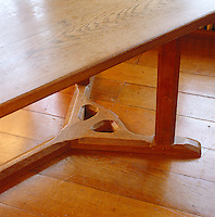 A detail of the legs and base of an Arts and Crafts dining table custom-designed by Ernest Barnsley for Rodmarton Manor