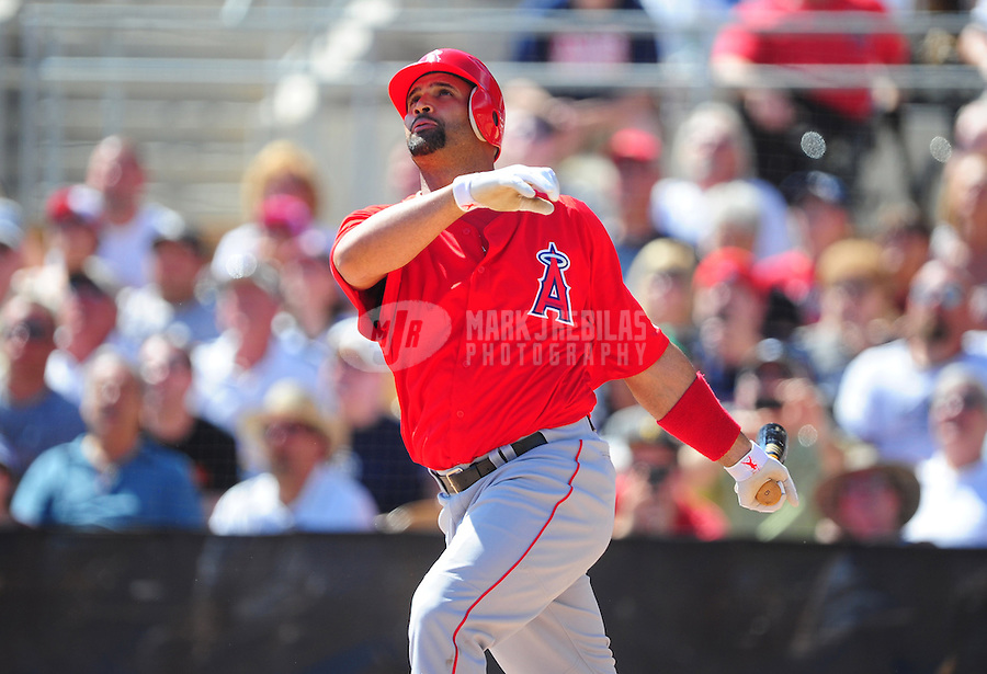 Mar. 14, 2012; Phoenix, AZ, USA; Anaheim Angels first baseman Albert Pujols hits a three run home run in the third inning against the Chicago White Sox at The Ballpark at Camelback Ranch. Mandatory Credit: Mark J. Rebilas-