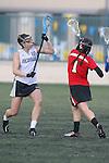 Santa Barbara, CA 02/19/11 - Alex Treadwell (Nevada-Reno #10) and Laura Hunter (Utah #1) in action during the Utah-Nevada Reno game at the 2011 Santa Barbara Shootout.