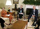 First lady Laura Bush, United States Secretary of Education Margaret Spellings and US President George W. Bush pose for photographers in the Oval Office at the White House September 6, 2005 in Washington, DC. President Bush spoke about efforts to assist students and school districts in the Gulf Coast states who were displaced by Hurricane Katrina.  <br /> Credit: Chip Somodevilla / Pool via CNP