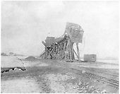 View of coaling trestle at Antonito with coke gondola hanging off the high end after having been pushed a little too far.<br /> D&amp;RG  Antonito, CO
