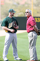 Kevin Kouzmanoff & broadcaster Ray Fosse. Oakland Athletics spring training workouts at the Athletics complex, Phoenix, AZ - 02/25/2010 & 02/26/2010.Photo by:  Bill Mitchell/Four Seam Images.