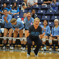 NWA Democrat-Gazette/ANDY SHUPE<br /> Springdale Har-Ber coach Shyrah Schisler celebrates a first-set win Thursday, Sept. 17, 2015, over Rogers Heritage at Wildcat Arena in Springdale. Visit nwadg.com/photos to see more photographs from the game.